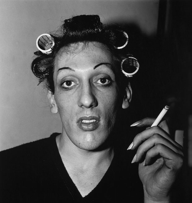 A-young-man-with-curlers-at-home-on-West-20th-Street,-N.Y.C.