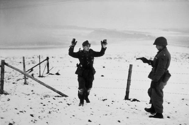 BELGIUM.-Near-Bastogne.-December-23rd-26th,-1944.-A-US-soldier-with-a-German-prisoner-of-war-during-the-Battle-of-the-Bulge.