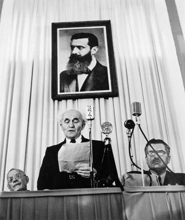 ISRAEL.-Tel-Aviv.-May-14th,-1948.-Founder-of-the-state-of-Israel,-David-Ben-Gurion-reads-the-proclamation-that-will-establish-Israel-as-an-independent-nation.