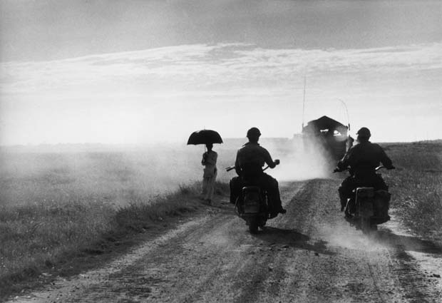 NDOCHINA-(VIETNAM).-May,-1954.-Motorcyclists-and-woman-walking-on-the-road-from-Nam-Dinh-to-Thai-Binh.
