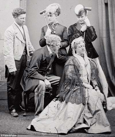 Stella-and-Fanny,-top-right-with-croquet-sticks,-loved-dressing-up-in-resplendent-women's-clothes-and-going-out-in-London-society-in-the-19th-century